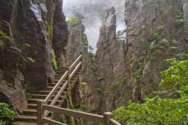 1.) Huangshan Paths (China): Huangshan is a mountain range in southern Anhui province in eastern China.  There are more than 30 touring paths in total in Huangshan mountains, and it is a UNESCO World Heritage Site. It