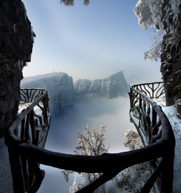 3.) The Walkways of the Tianmen Mountain (China): Tianmen Mountain is a mountain located within Tianmen Mountain National Park, Zhangjiajie, in northwestern Hunan Province, China. The Tianmenshan Guigu Cliff Path is built among cliffs and tourists can walk on these paths built onto the cliff face at the top of the mountain, including sections with glass floors. It is one of the worlds highest observation platforms.