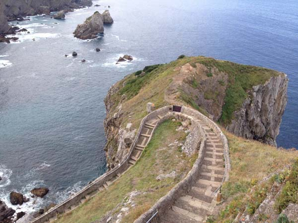 5.) Path to Gaztelugatxe (Spain): This path is located on Gaztelugatxe in Spain, a tiny islet on the coast of Biscay belonging to the municipality of Bermeo, in Basque Country (Spain). A hermitage from the 9th or 10th century stands on top of of the island, connected to a narrow stone path filled with steps.