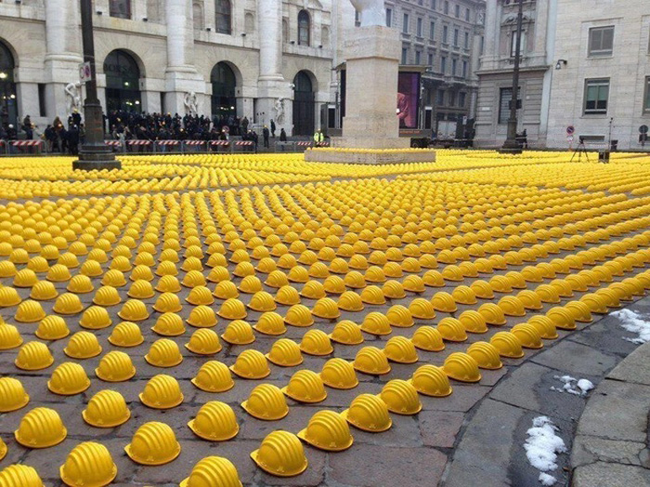 Factory workers lay down their hard hats in the streets of Italy.
