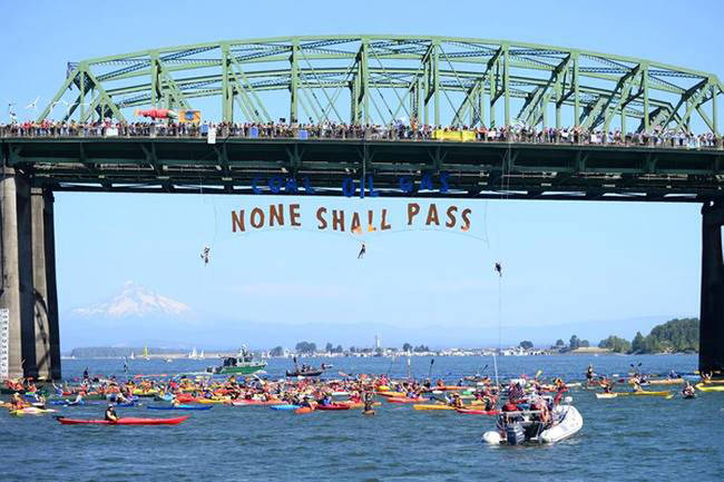Residents of Portland protest the transportation of coal, gas, and oil.
