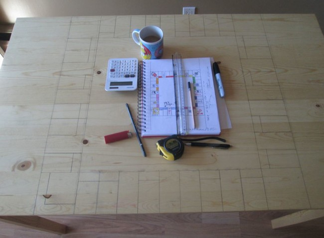 The sketch was transferred onto the tabletop with pencil and careful measuring.