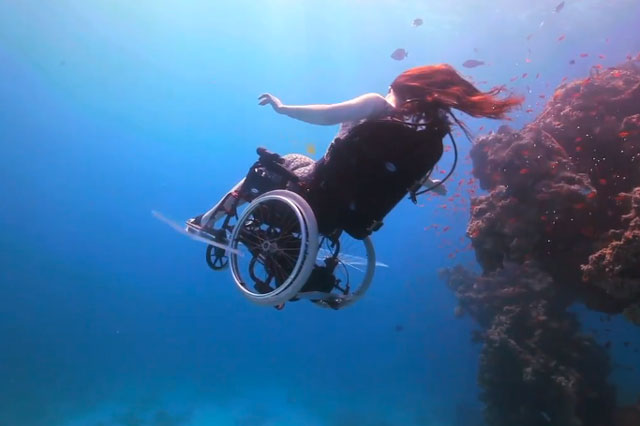 The chair is equipped with swimming floats, fins and two foot-controlled drive propulsion vehicles.
